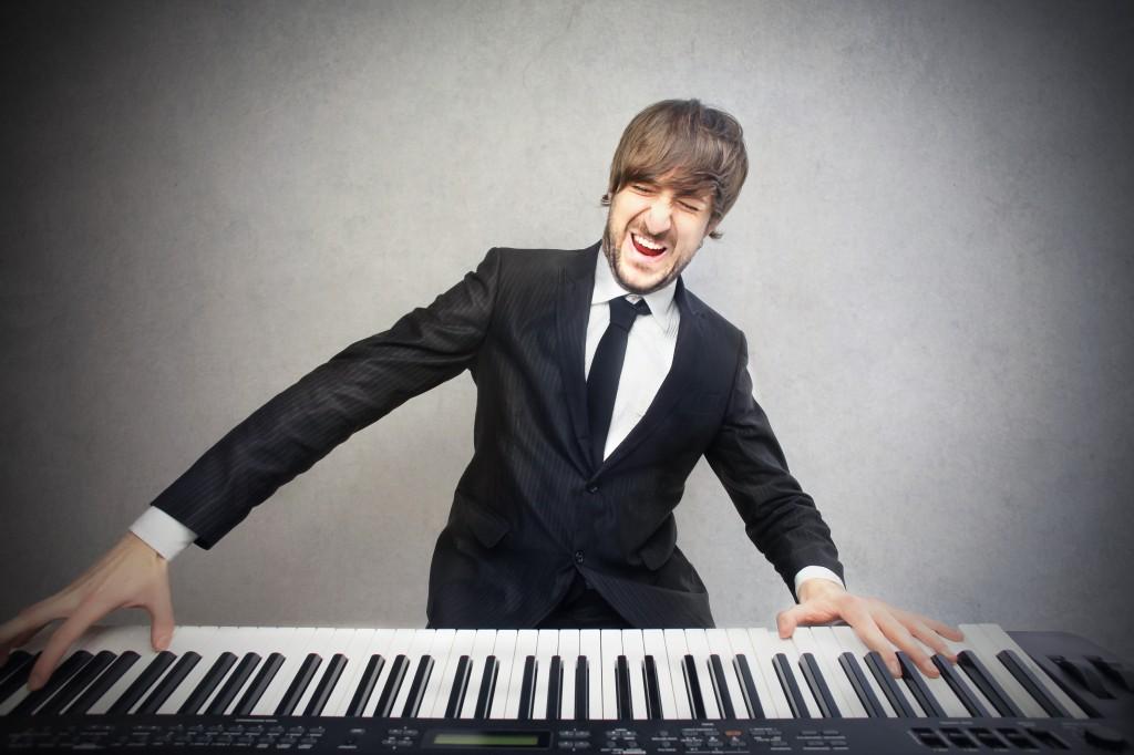 man playing pianoforte